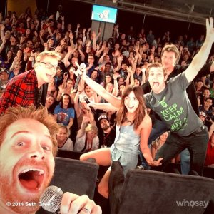 Seth Green taking a selfie of a Nerd HQ panel featuring himself, Liam McIntyre, Nathan Fillion, Chloe Bennett, and Alan Tudyk