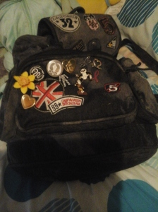 My charity badge collection, minus my nerd machine button