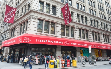 """NEW YORK, NY - NOVEMBER 05: A general view of the exterior facade of The Strand Bookstore on November 5, 2014 in New York City. The company's slogan is """"18 Miles Of Books."""" (Photo by Ben Hider/Getty Images)"""